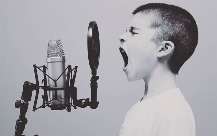 Boy Shouting At Microphone