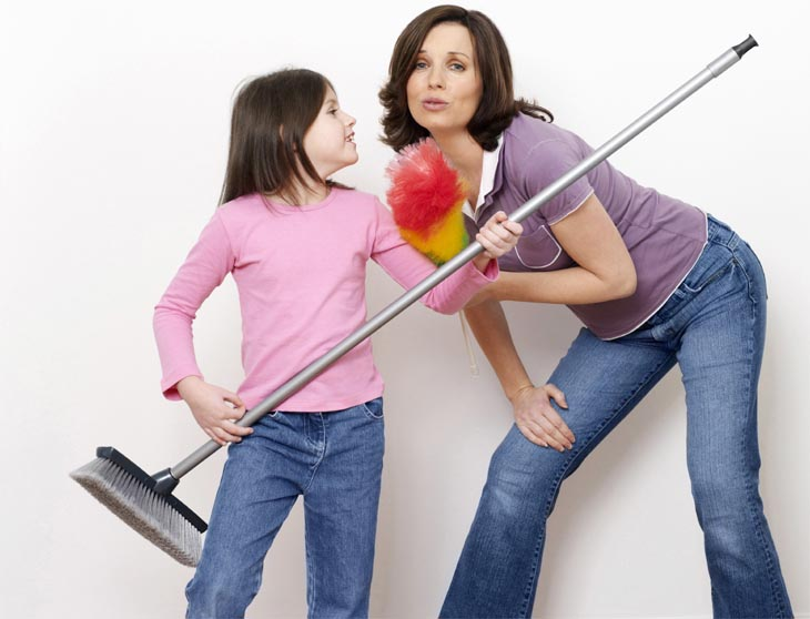 Mother And Daughter Getting Ready For Some Cleaning